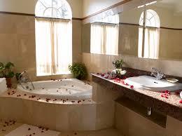 romantic bathroom decorating ideas messy roses on the floor of bathroom with corner bathtub for