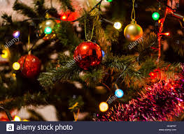 tree balls and ornaments in different colours stock photo