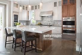kitchen pendant lighting over island pendant lights over modern white kitchen island stock photo within