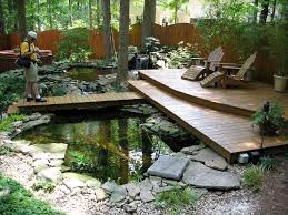 modern corner house garden ideas with statue and waterfall design