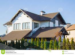 house with beautiful iron fence and car parking stock photo