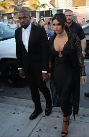 kim kardashian busts out in lace dress at wedding in miami