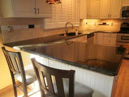 uba tuba granite with white cabinets integrity installations