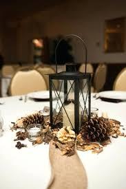 table decorations with pine cones pine cone centerpieces wedding lantern winter centerpiece ideas