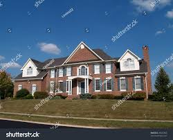 large two story brick residential home stock photo 38243803