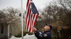 Flying The Us Flag Upside Down Navy Veteran Hangs American Flag Upside Down In Trump Protest