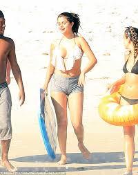 skimpy swimwear for 2014 selena gomez shows off her new curves in skimpy frilled bikini top