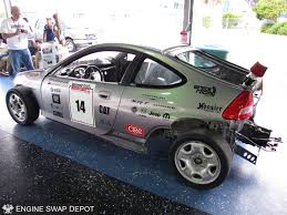 subaru honda wreck racing u0027s honda insight with a subaru flat six car