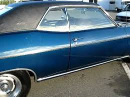 69 impala with custom candy blue pearl paint job in the sun