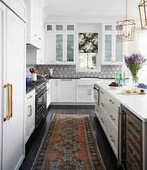 white cabinets with black countertops and backsplash 75 beautiful kitchen with marble backsplash and black