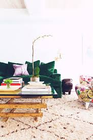 the rich colors and unique fabrics give this room an adventurous