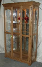 solid oak china cabinet solid oak framed mirror back glass display cabinet by clayborne s