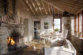 roaring fireplace in cozy beach cottage w original stone walls