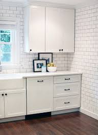 white cabinets with black oil rubbed bronze hardware and a white