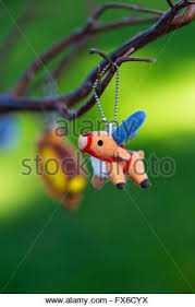 animal ornament hanging from a sparse tree branch at a wedding