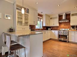 love the wood backsplash all around the kitchn and the house