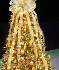 white christmas tree with gold decorations christmas lights