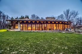 frank lloyd wright inspired home with lush landscaping quirky frank lloyd wright inspired 70s home asks 590k curbed
