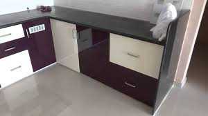 high gloss purple and kream colour modular kitchen in bharuch