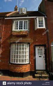 traditional georgian red brick built building with bow window in a stock photo traditional georgian red brick built building with bow window in a back street of brighton sussex