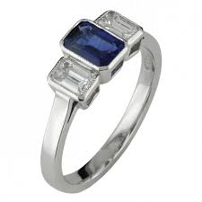 bezel set sapphire and diamond three stone ring