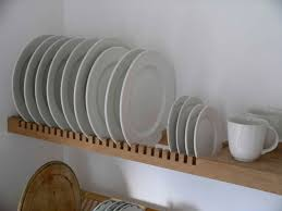 kitchen plate rack is an extension of the solid beech shelf for