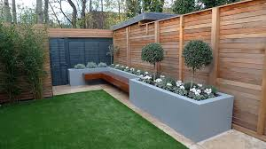 garden wall plants artificial grass tile grey colour scheme walls fence planting