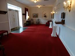 featured work lowe funeral home custom home flooring and rugs we worked with shaw hospitality group to find just the right design early on paula was drawn to red and gold carpet with a medallion and border