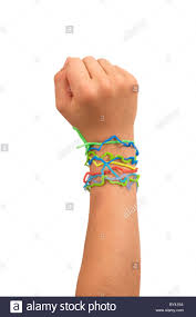 hand rubber bracelet images Child hand in fist wearing silly shaped rubber band bracelets on jpg