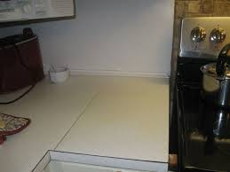 what of paint do you use on formica cabinets i want to cover up or paint my formica counter tops in