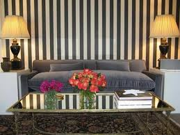 living room with grey sofa and striped wallpaper decorating with