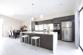 island bench kitchen designs charcoal and white kitchen design with waterfall ends to island