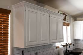 how to paint wood cabinets white how to paint kitchen cabinets with knots addicted 2 diy