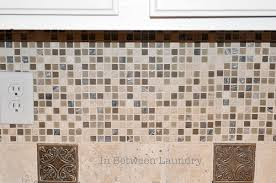 how to install a mosaic tile backsplash in the kitchen in between laundry tutorial how to install a mosaic tile backsplash
