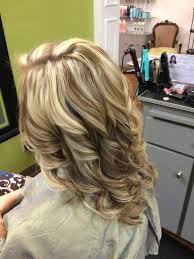 hi and low lights on layered hair new hair blonde highlights and honey carmel low lights by bertha