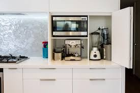 kitchen appliance storage cabinet appliance pantry bi fold doors white modern kitchen www