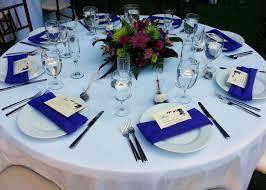 wedding cake napkins purple napkins white tablecloths wedding reception outdoor wedding