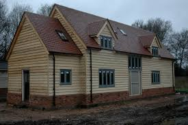 border oak weatherboarded barn style home under construction