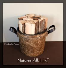 decorative faux leather bucket filled with split cedar fireplace