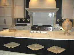 white kitchen with island granite countertop kitchen with red cabinets chrome backsplash