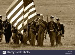 Soldier With Flag Union Soldiers Carrying The Flag In A Civil War Re Creation Stock