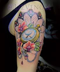 pocketwatch and orchid tattoo by liz venom from bombshell tattoo
