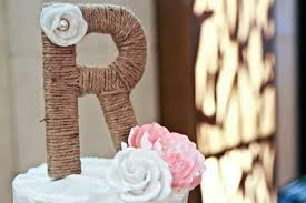 twine wrapped monogram wedding cake topper with hand made silk