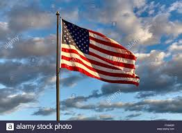 American Flag On The Moon American Flag On Flagpole Waving In The Wind Against Clouds Blue