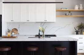 white kitchen cupboards black bench black island bench white kitchen cabinetry contemporary
