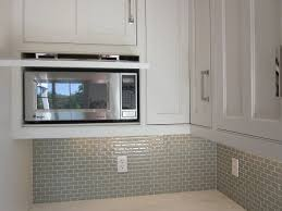 microwave hidden behind drop down door kitchens pinterest