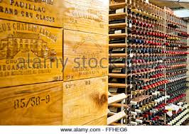 Temperature Controlled Wine Cellar - collected bottles of wine in racks in a well stocked private stock