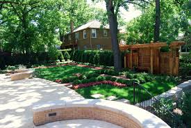 large modern backyard landscaping house design with green grass