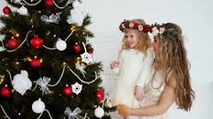 family around tree new year s holidays stock