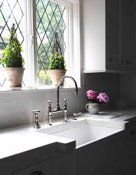 tone on tone thick marble countertops leaded glass windows